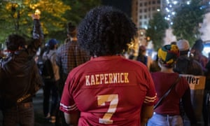 A woman wears a Colin Kaepernick jersey during a George Floyd protest near the White House on Wednesday in the nation's capital.
