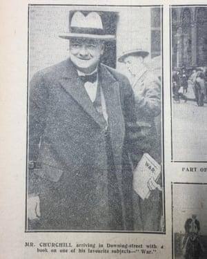 Winston Churchill carrying 'War' book