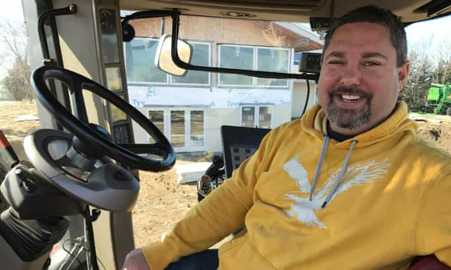 Farmer and technician Kyle Schwarting, from Ceresco, Nebraska, in the cab of his Case IH tractor.