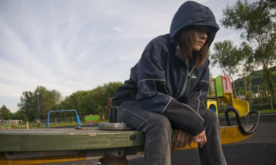 teenage girl wearing hoodie