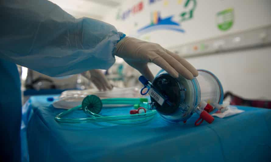 A nurse in Wuhan, China, works in an intensive care unit where ECMO treatment is used for Covid-19 patients.