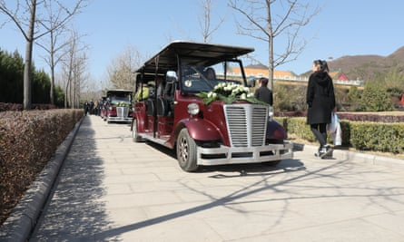 Golf carts made to look like hearses are used as part of the eco burial ceremony.