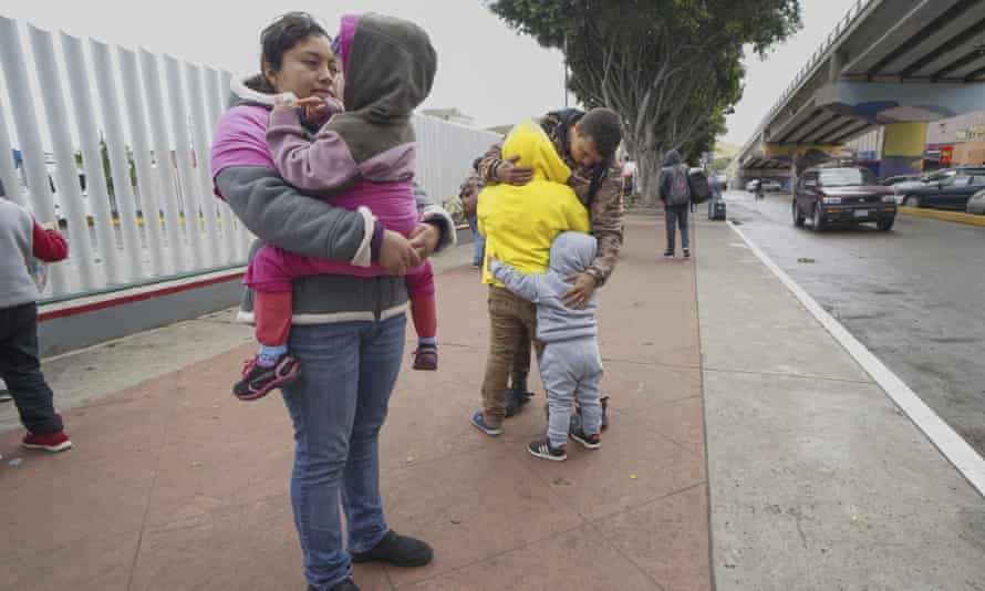 Honduran migrants wait in line to plead their asylum cases at the El Caparrel border crossing on 2 March 2020 in Tijuana, Mexico.