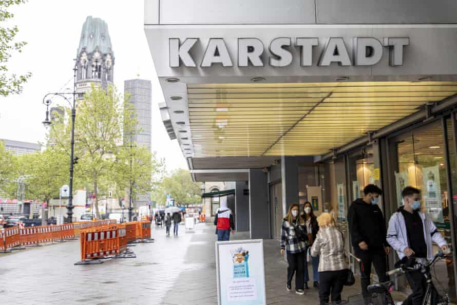 People queue outside Karstadt shopping centre during the coronavirus crisis in Berlin.