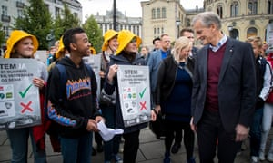 Norway's Labour party leader, Jonas Gahr Støre, right, talks with environmentalists at an campaign event in Oslo.