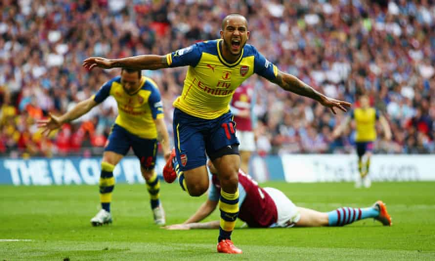Theo Walcott celebrates after scoring against Aston Villa in the FA Cup final