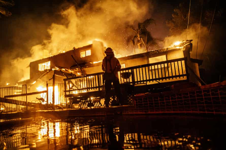 Firefighters work to control flames from spreading as embers threaten to burn homes in the North Park neighborhood at the Hillside Fire in San Bernardino, on 31 October 2019.