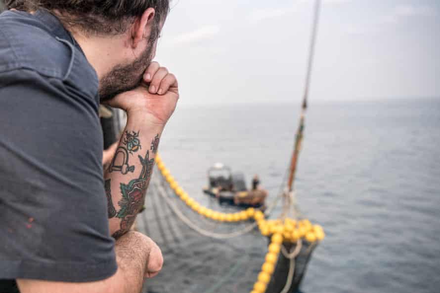 Captain Alistair Allan looks on as the Oriental Kim's net is winched aboard