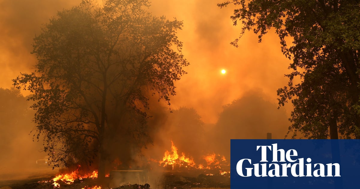 California wildfires: rapidly growing blazes force thousands to flee