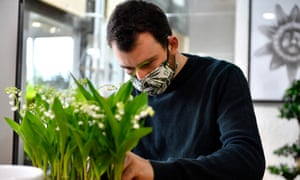 A florist is seen preparing Lily of the Valley orders in celebration of Labour Day during the coronavirus pandemic in La Celle Saint Cloud, France.