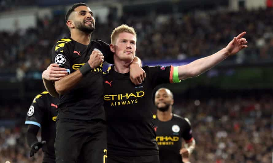 Kevin De Bruyne celebrates with Riyad Mahrez after scoring Manchester City's second and decisive goal at Real Madrid.