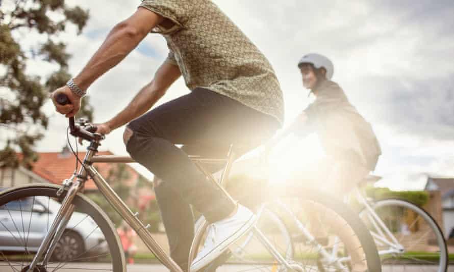 Couple riding bikes.