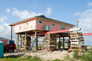 A contractor looks at a home he is raising to comply with the new requirements for homes being built and or repaired on the Bolivar Peninsula.