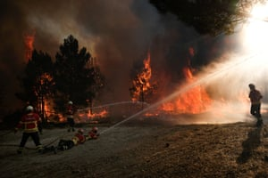 Firemen fight a forest fire at Abrunhosa-a-Velha and Torre de Tavares village, central Portugal