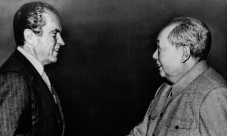 President Richard Nixon shakes hands with Communist Chinese leader Mao Tse-Tung during his historic trip to Communist China on 21 February 1972.