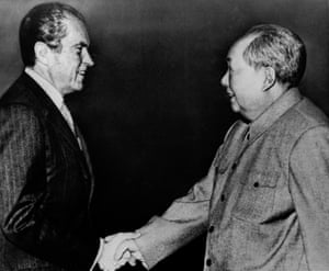 US president Richard Nixon shakes hands with Chinese leader Mao Zedong on 21 February, 1972 in Beijing.