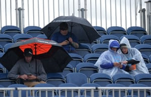 Spectators shelter from the rain during the final day of the Aberdeen Ladies Scottish Open at Gullane golf course.