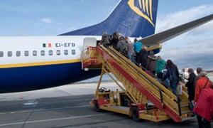 Passengers entering a Ryanair plane