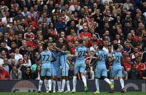 Happy City players celebrate infront of the disappointed United fans.
