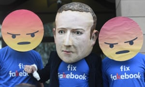 A Mark Zuckerberg figure with people in angry emoji masks outside Portcullis House ahead of Mike Schroepfer, Facebook chief technology officer, appearing before the DCMS inquiry into fake news.