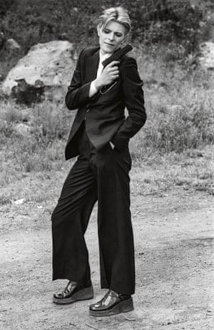 David Bowie strikes a pose on set.