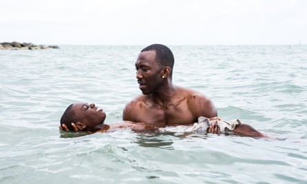 Alex Hibbert as the young Chiron with Mahershala Ali in Moonlight.