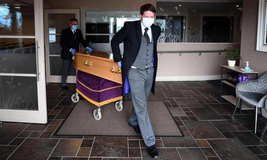The coffin of a care worker who died from Covid-19 is transported at Emslie S Collier and Son funeral directors in Montrose, Scotland.