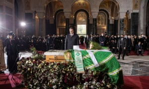 Serbian president Aleksandar Vucic pays his respect by the casket of Serbia's late Patriarch Irinej, who died of coronavirus, during funeral rites at Belgrade's St Sava temple, in Belgrade, Serbia