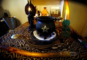 Rudy Alderette's altar in his Fresno, California home includes a cauldron with a pentagram, a wand, chalice, statues of the Wiccan god and goddess and incense holder.