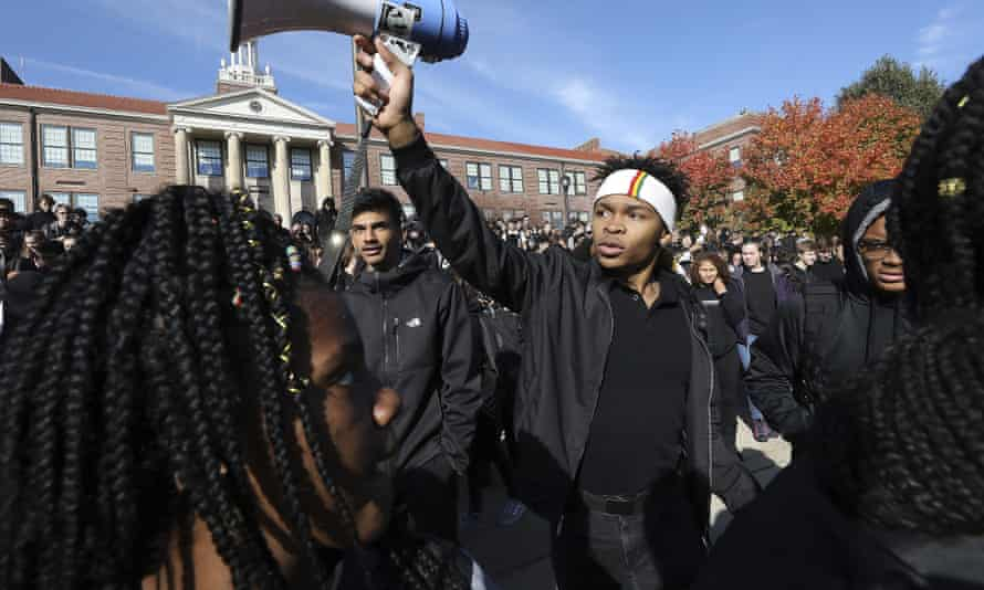 Madison West High School senior Noah Anderson, 17, president of the school's Black Student Union and son of the school's recently-fired security guard Marlin Anderson, leads a rally in support of his father outside the school in Madison, Wisconsin, on Friday.