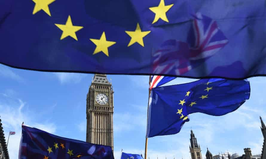 EU flags and a union flag fly next to Elizabeth Tower during a Unite for Europe rally in Parliament Square in London.