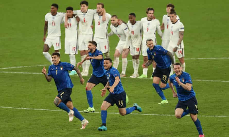 England players can only look on as Italy celebrate their penalty shootout win at Wembley.