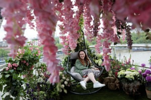 London, England A guest sits inside a garden themed installation inside a pod on the London Eye ahead of the Royal Chelsea Flower Show