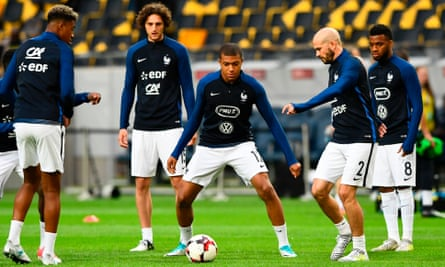 France's forward Kylian Mbappe (C) and his teammates warm up before the World Cup 2018 qualification football match against Sweden in Solna, Sweden, on June 9, 2017.