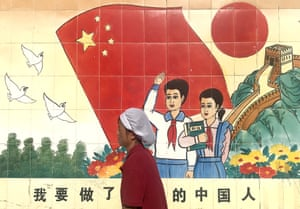 Beijing, China: A mural extolling the virtues of the Communist party's education policy
