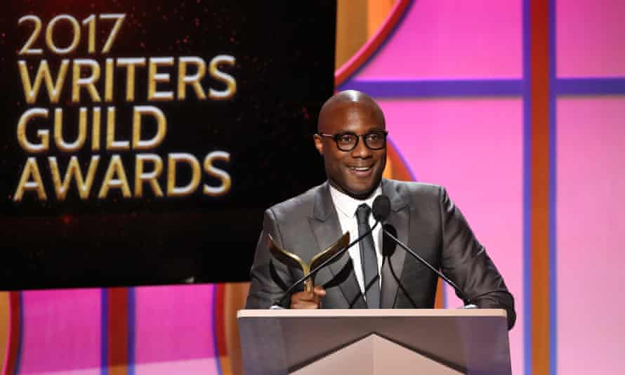 Barry Jenkins collects his award for best original screenplay at the Writers Guild of America awards in Los Angeles