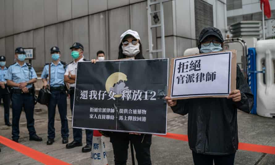Family members of Hong Kong residents detained in China protest outside the Beijing liaison office on 30 September.