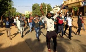 Demonstrators march through Khartoum