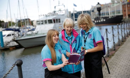 On Hull marina volunteers look at the programme for Hull UK City of Culture 2017, which will focus national attention on the city