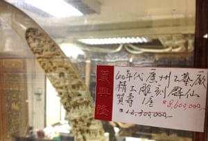 An expensive antique ivory piece entitled 'birthday party' is seen for sale for $HK8.6m (£717,000) at an antique shop. Undercover video provided to WildAid and WWF-Hong Kong from anonymous investigators show definitive proof of traders engaging in illegal activity.