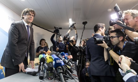 Charles Puigdemont (left) gives a statement during a press conference in Brussels.