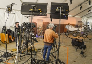 TV crews set up for live coverage of the landing, next to a model of the rover, at Nasa's jet propulsion laboratory