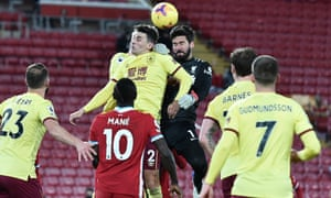 Liverpool's Alisson goes up for a header with Burnley's Matthew Lowton.