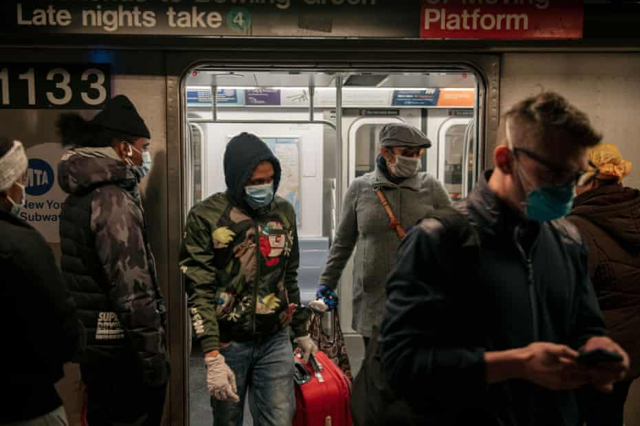 Commuters wear face masks as they exit a subway train on April 17, 2020 in New York City. Following a new order from Governor Andrew Cuomo that New Yorkers must wear face coverings whenever social distancing is not possible, the measure is the latest in a series of communal steps taken to stop the spread of the deadly coronavirus (COVID-19).