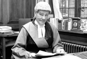 Lord Widgery, the lord chief justice, pictured in 1972 in his room at the Old Bailey as he looks through his report on the Bloody Sunday shootings.