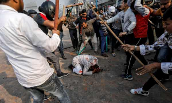 Mohammad Zubair, 37, is beaten by a Hindu mob in one of the most shocking images from a week of violence in Delhi.