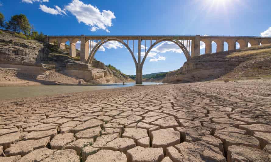 Cracked earth under bridge