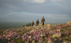 Kurdistan Workers' party (PKK) guerrillas members on an armed patrol in the countryside of Makhmur, in Iraq.