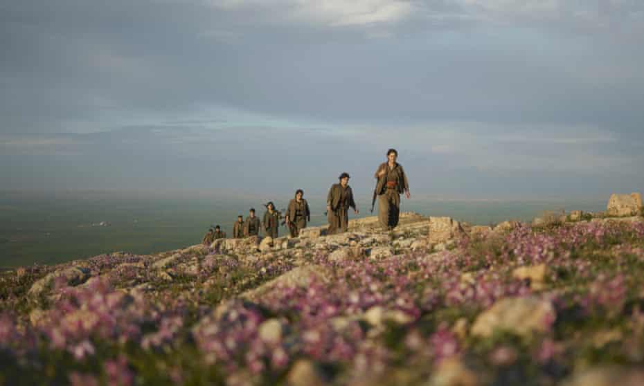 Kurdistan Workers' party (PKK) guerrillas members on an armed patrol in the countryside of Makhmur, in Iraq.