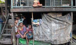 A Rohingya family in Aung Mingalar ghetto, Rakhine state, Myanmar.